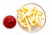 Bowl of chips and ketchup from above — Stock Photo