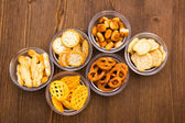 Pretzels in bowls on wood from above — Stock Photo