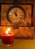 Uhr und Kerze — Stockfoto
