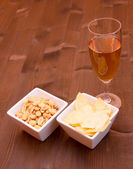 Aperitif and pretzels on wood — Stock Photo