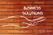 Successful business solutions in your hands — Stock Photo