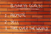 List of business goals: promote, sell, take over the world — Stockfoto
