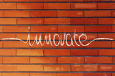 Calligraphic handwriting with the word Innovate — Stock fotografie
