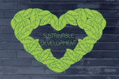 Ecology and green economy, heart made of leaves — Stock Photo