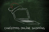 Computer with santa claus hat, concept of Christmas shopping online — Stock Photo