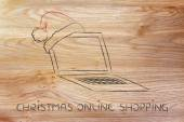 Computer with santa claus hat, concept of Christmas shopping onl — Stock Photo