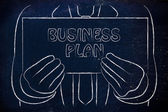 Hombre con cartel de Plan de negocios — Foto de Stock