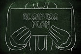 Man holding Business Plan sign — Stock Photo