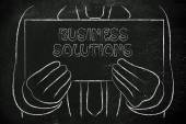 Man holding Business Solution sign — Stock Photo