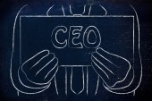 Business man holding CEO sign — Stock Photo