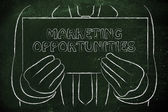 Man holding Marketing Opportunities sign — Stock Photo