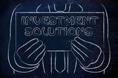 Man holding investment solutions sign — Stock Photo