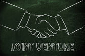 Joint venture write with hands shaking — Stock Photo