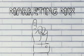 Hand pointing at the writing marketing mix — Stock Photo