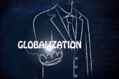 Business man holding the word Globalization — Stockfoto