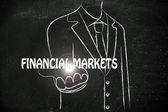 Business man handing out the word Financial Markets — Stock Photo
