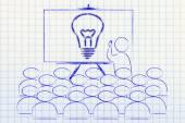 Seminar with man drawing a brilliant idea — Stockfoto