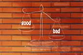 Metaphor of balance measuring the good and the bad — Stock Photo