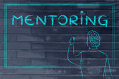 Teacher writing on blakboard about mentoring — Stock Photo