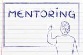 Teacher writing on blakboard about mentoring — Stockfoto