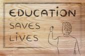 Teacher writing on blakboard: education saves lives — Stock Photo
