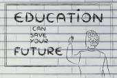 Teacher writing on blakboard about education — Стоковое фото