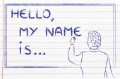 Teacher writing on blakboard: Hello, my name is... — Stock Photo