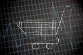 Carrinho de compras em fundo de estatísticas financeiras — Fotografia Stock