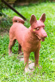 Thai dog statue on grass — Stock Photo