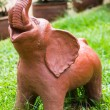 Elephant clay dolls in the garden — Stock Photo #52309135
