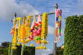Colorful artificial garland for place of worship — Stock Photo