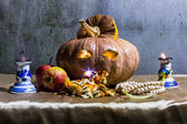 Halloween still life with pumpkins, apple, candles and rosary — Foto de Stock