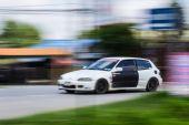 White car Speeding in road — Stock Photo