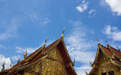 Chapel in Thai temple architecture against blue sky — Stock Photo