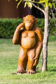 Monkey statue in lawn — Stock Photo