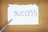 Success writing on white paper — Stock Photo