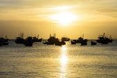 Sunset at fishing village — Stock Photo
