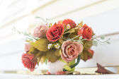 Artificial flowers in the vase — Stock Photo