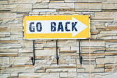 Go back sign on the wall — Photo