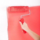 Hand painting wall in red — Stock Photo