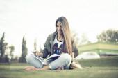 Beautiful teenage girl with phone and coffee — Stock Photo
