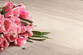Bouquet of pink fresh tulips on wooden background — Stock Photo