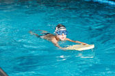 Activities on the pool young boy swimming fitness — Stock Photo