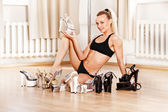 Young slim pole dance woman choosing shoes for strip tease — Stock Photo