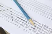 Standardized test form with answers bubbled in and a pencil, foc — Stock Photo