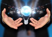 Businessman holding Light bulb,concept get idea  — Photo