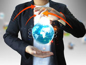 Businessman holding globe, connected — Stock Photo