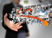Hand som håller affärsvärlden — Stockfoto