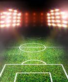 Soccer field and spotlights — 图库照片