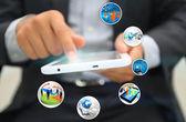 Businessman holding smartphone — Stock Photo